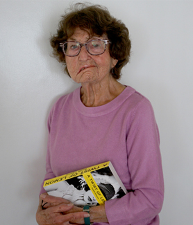 Rosalie Schwartz holding her latest book A Twist of Lemon