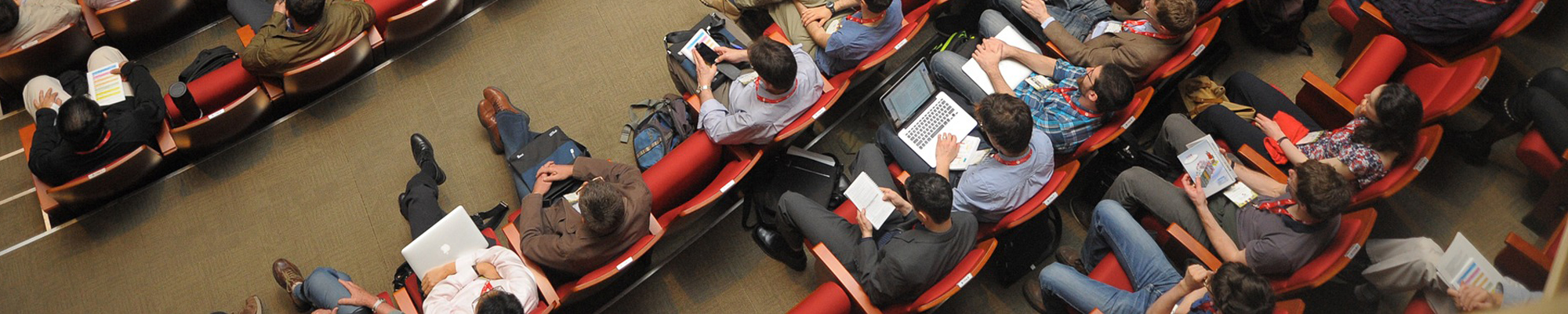 aerial view of people in a classroom or lecture hall